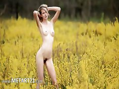 blond babe touching herself on field