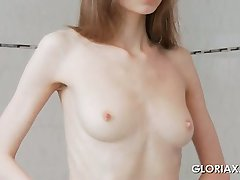 Teen skinny doll Gloria touching little pussy in the mirror