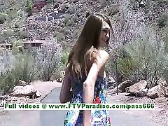 Holly sensual brunette woman getting naked outdoor and flashing