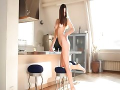 Teen wow glamour teasing in a kitchen